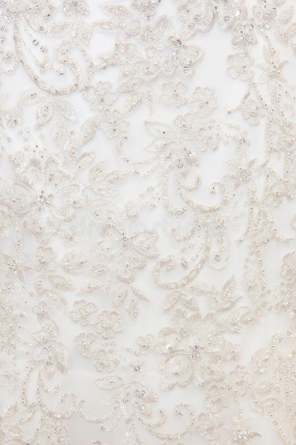 Background texture of white fabric with embroidery royalty free stock image