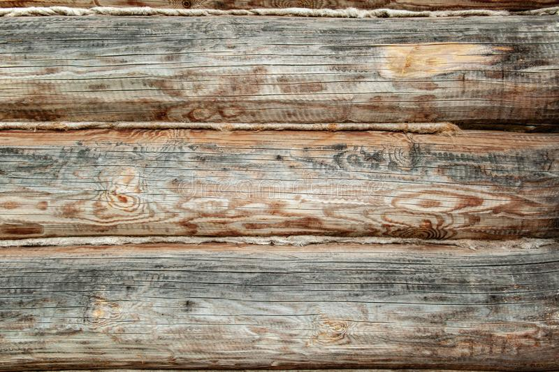 Background Textured wooden oak beams are warmed with towels in an old house. Warming of living space from logs.  stock photo