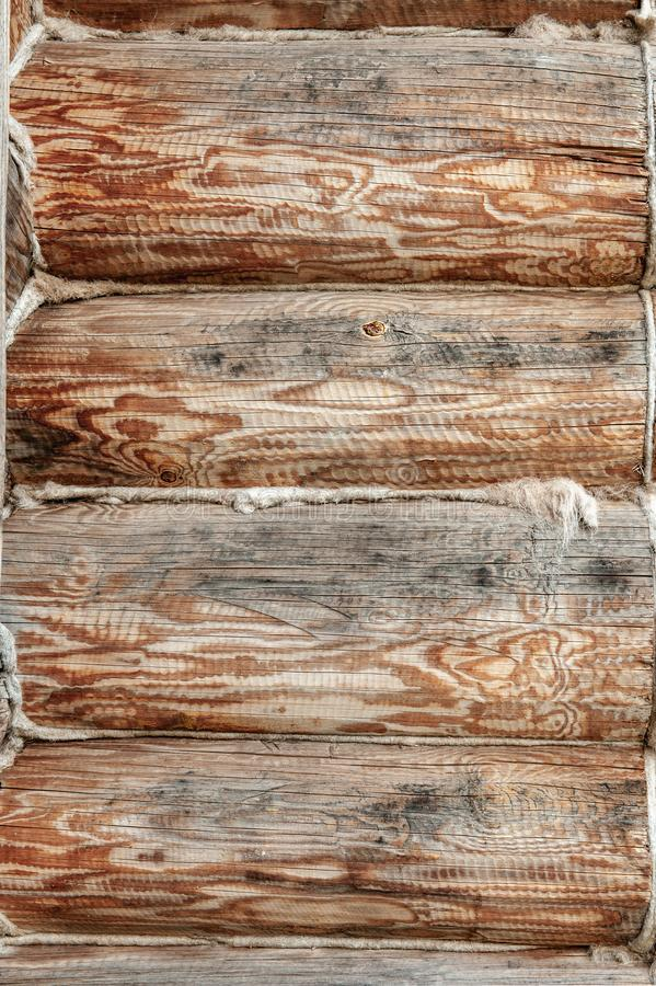 Background Textured wooden oak beams are warmed with towels in an old house. Warming of living space from logs.  royalty free stock photos