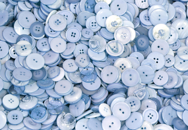 Background of thousands of light blue button stock photos