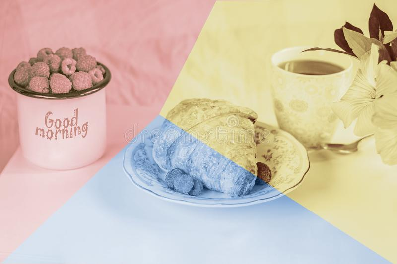 Background of three different color paper sheets pink, blue, yellow.  Breakfast in bed. Delicious Breakfast; coffee and croissant with raspberry, flowers royalty free stock image