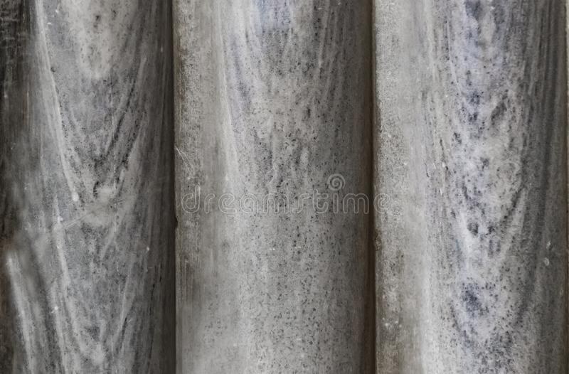 Background of three old marble pillars butted up together - close-up gray with blue tones stock photos