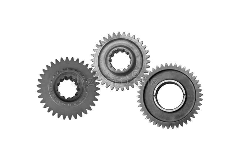 The gear wheels with cogs. Background of three steel  gear wheels with cogs but not interlocking and without drive shaft, white background stock photo
