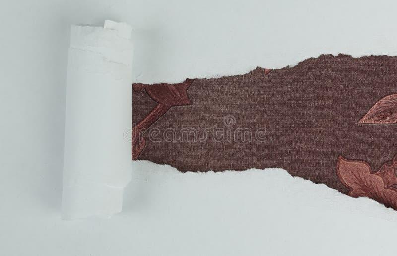 Torn sheet of paper in beautiful fabrics. Background .torn sheet of paper in beautiful fabrics royalty free stock photo