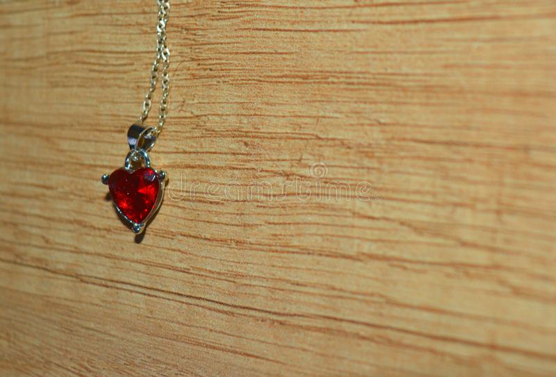 Valentine`s Day with the pendant heart royalty free stock image