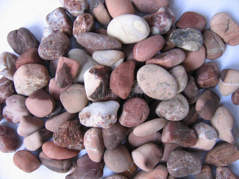 Background type view of small rocks on a pavement road. Small Stone Background stock image