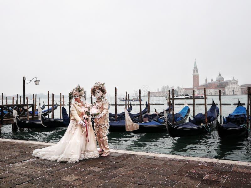 Venetian romantic couple masks masquerade in Venice italy royalty free stock photography