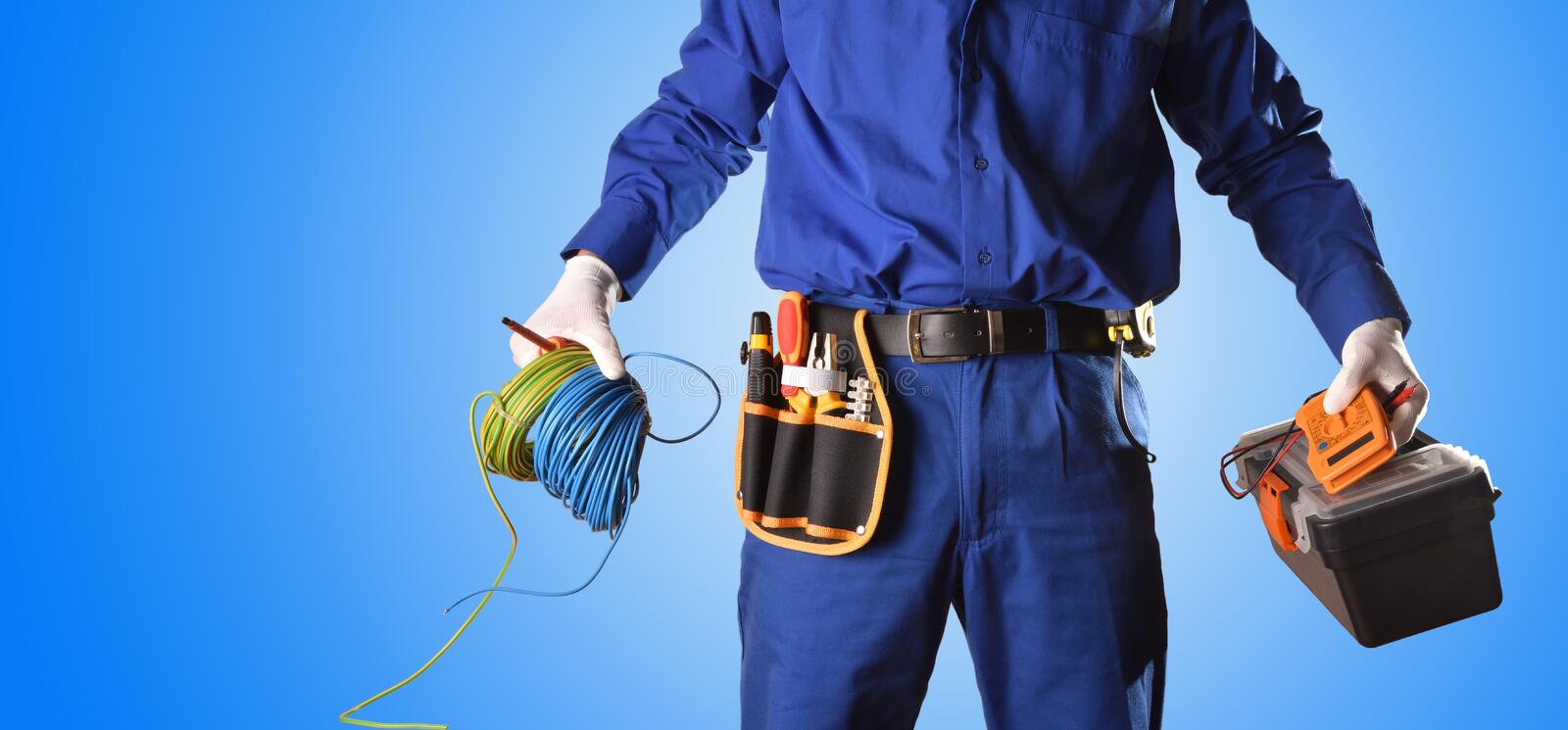Background uniformed electrician with tools and electrical equipment only body royalty free stock images