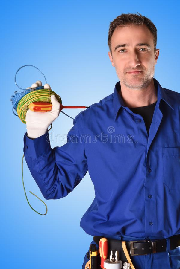 Background uniformed electrician with tools and electrical equipment vertical stock photos