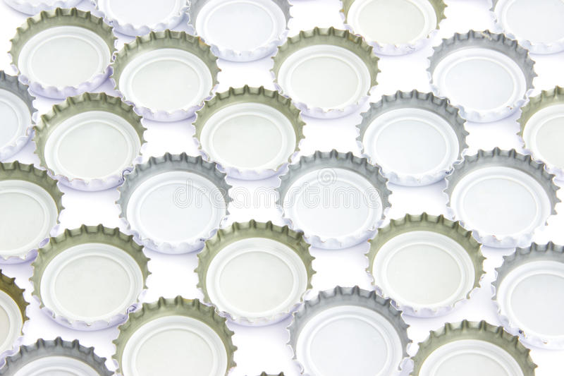 Background of used beer caps stock image