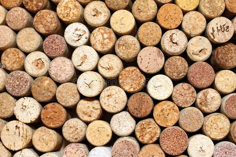 Background of used wine corks, wall of many different wine corks closeup stock image