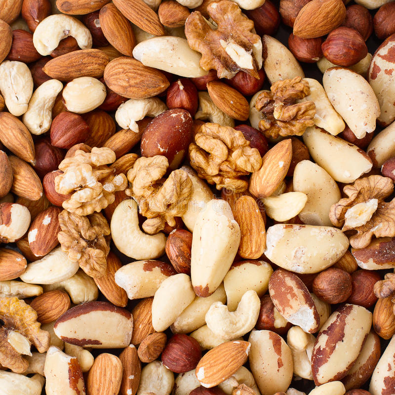 Background from various kinds of nuts stock photography