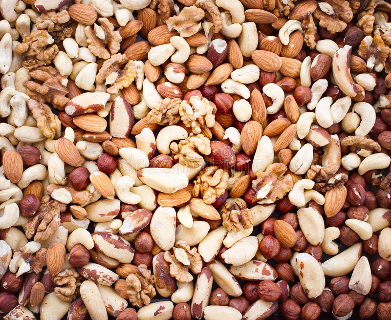 Background from various kinds of nuts royalty free stock photos