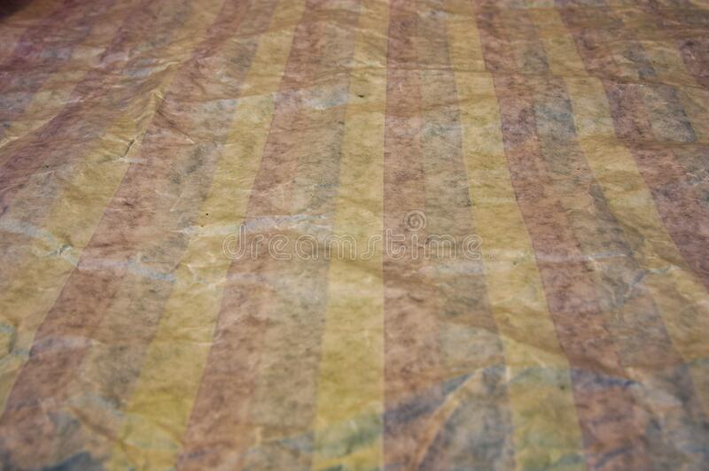 Background of vertical lines of various colors on a crumpled paper royalty free stock photo