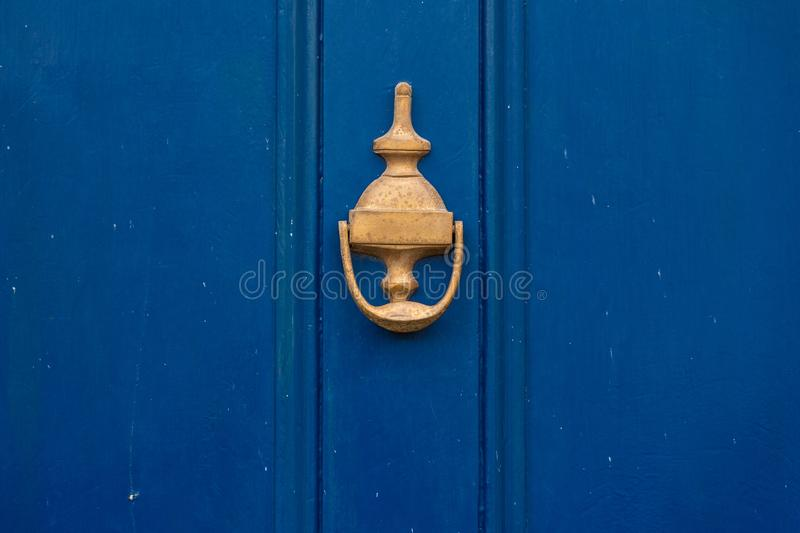 Background of vintage blue painted door and knocker vignette look made of old fashioned vintage brass metal stock images