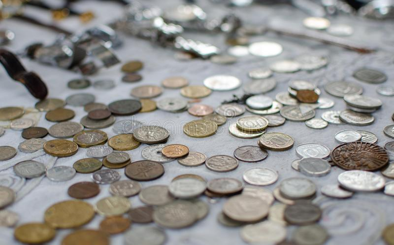 Background of vintage israeli and foreign coins for sale at Old Jaffa Flea Market. Israel royalty free stock image
