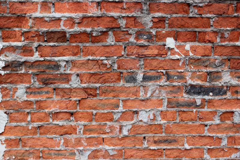 Fragment of a wall from an old rough brick royalty free stock images