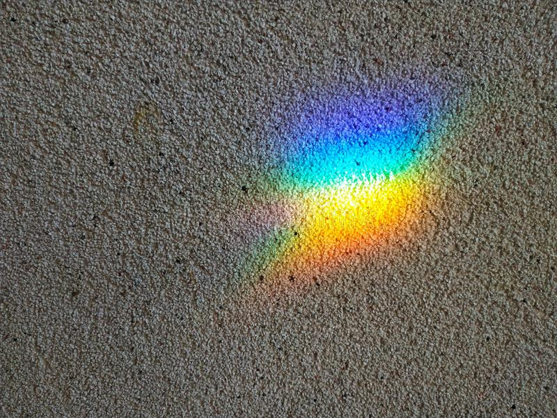 The background of the wall on which the rainbow spot. stock images