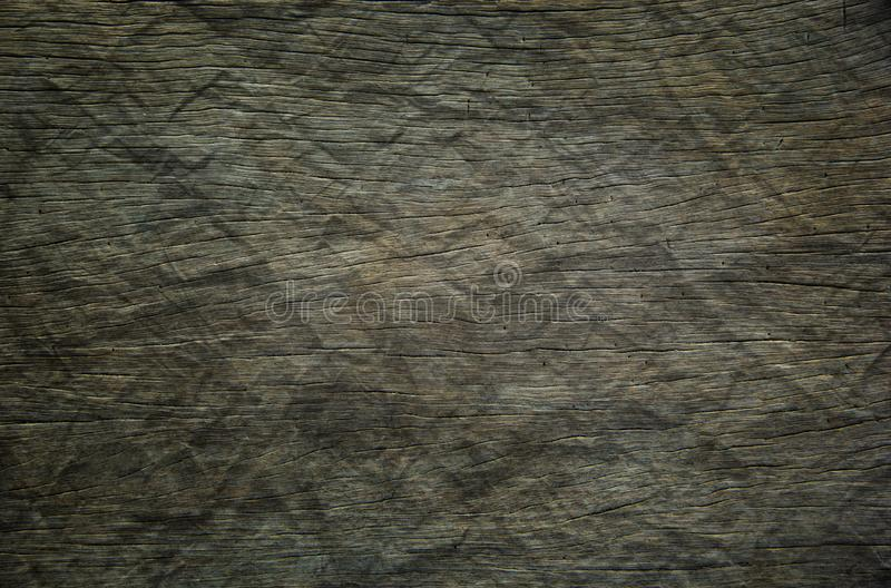 Background of dark hardwood floors polished and crumpled like paper. Background or Wallpaper and Detail of dark hardwood floors polished and crumpled like paper stock photo