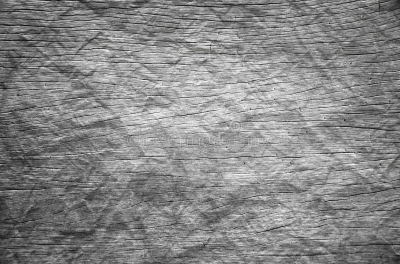 Background of dark hardwood floors polished and crumpled like paper. Background or Wallpaper and Detail of dark hardwood floors polished and crumpled like paper royalty free stock photo