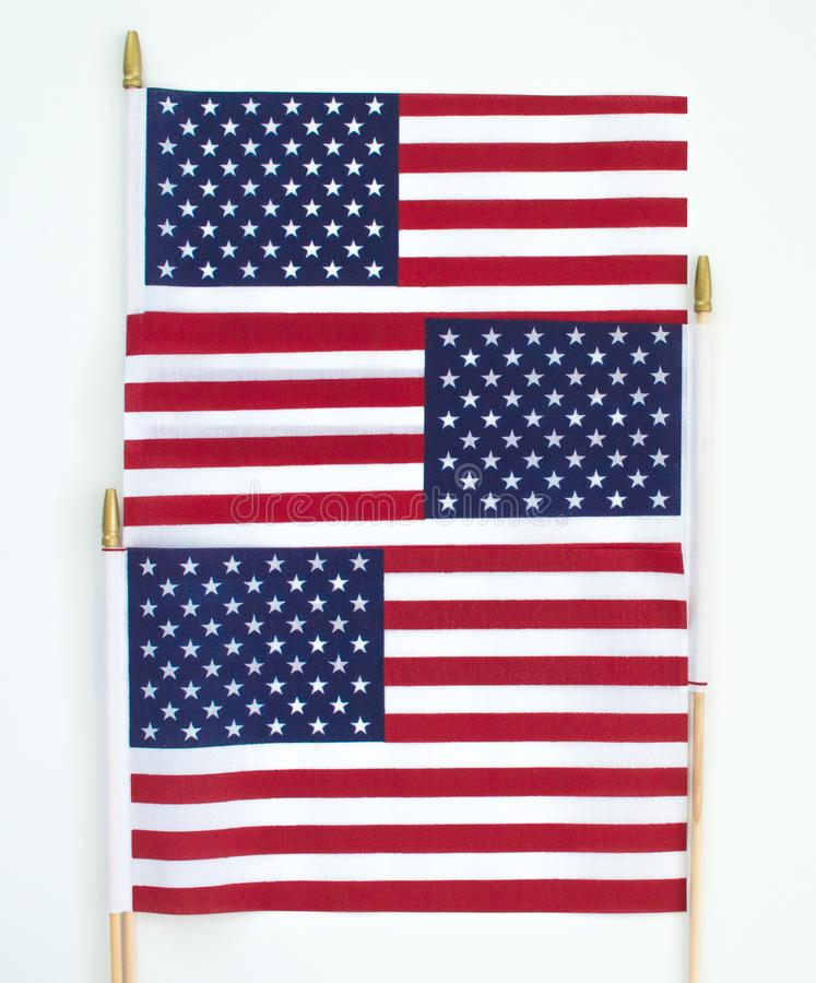 Background wallpaper three American flags in a row royalty free stock images