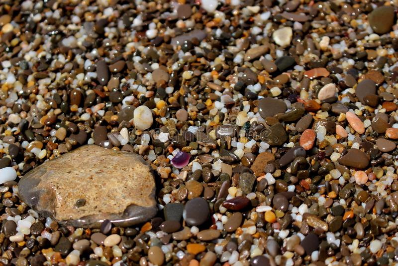 Background small bright pebble stock photos