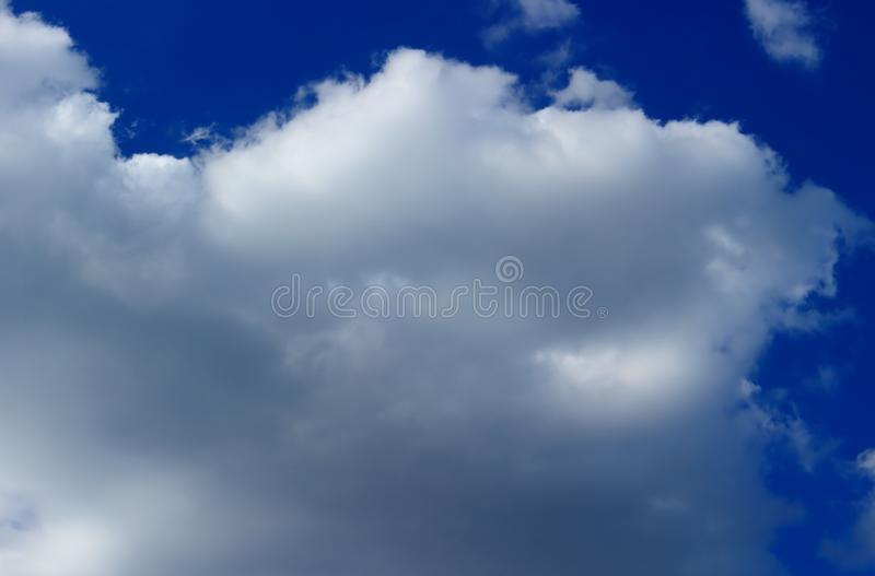 Fluffy cloud on sky royalty free stock photography