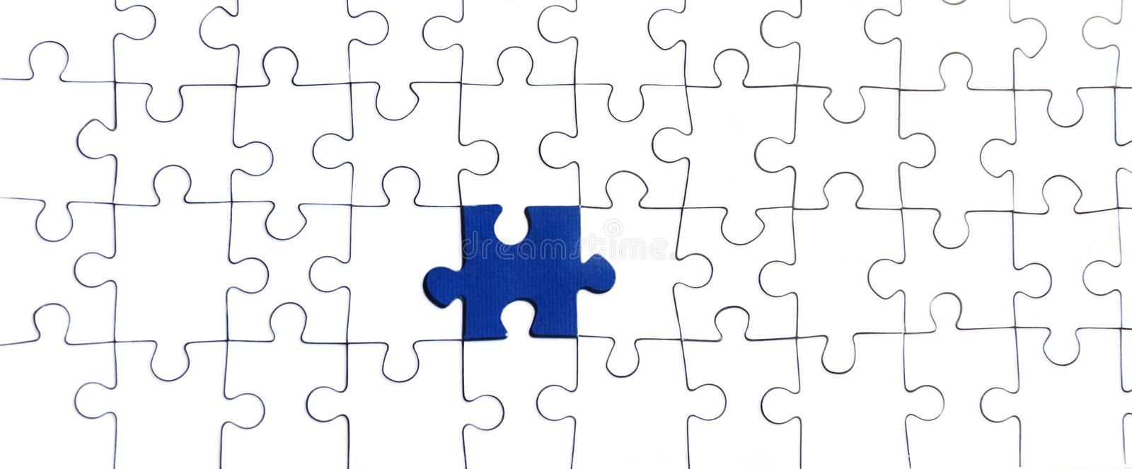 Background of white puzzle with bright blue puzzle center royalty free stock photo