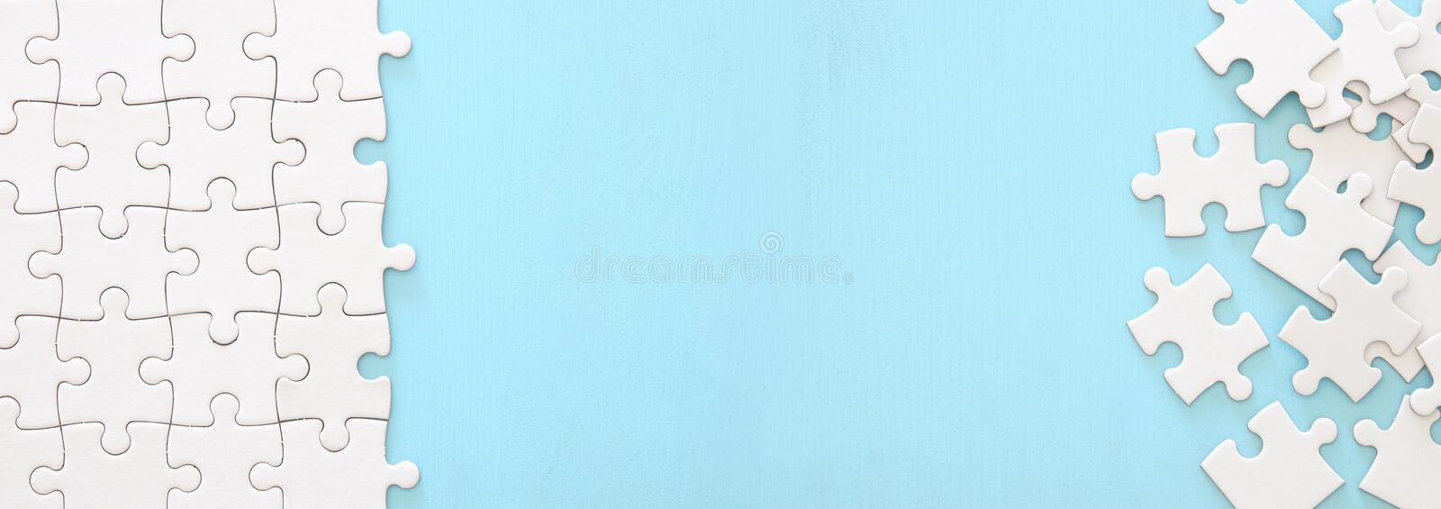 background of white puzzle with missing piece. Banner. royalty free stock photography