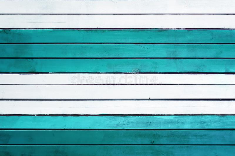 Background of white and turquoise horizontal slats. Texture of thin boards. Background of white and turquoise horizontal slats. Texture of painted thin boards royalty free stock images