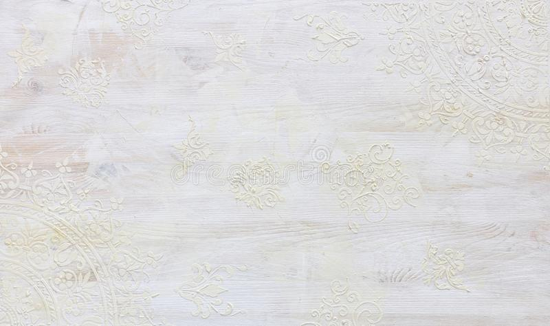 Background of white wooden vintage wall with floral emboss details royalty free stock image