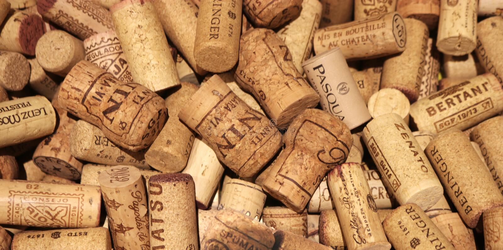 Background with wine and champagne corks. Brown background with used wine and champagne corks, full frame stock photo