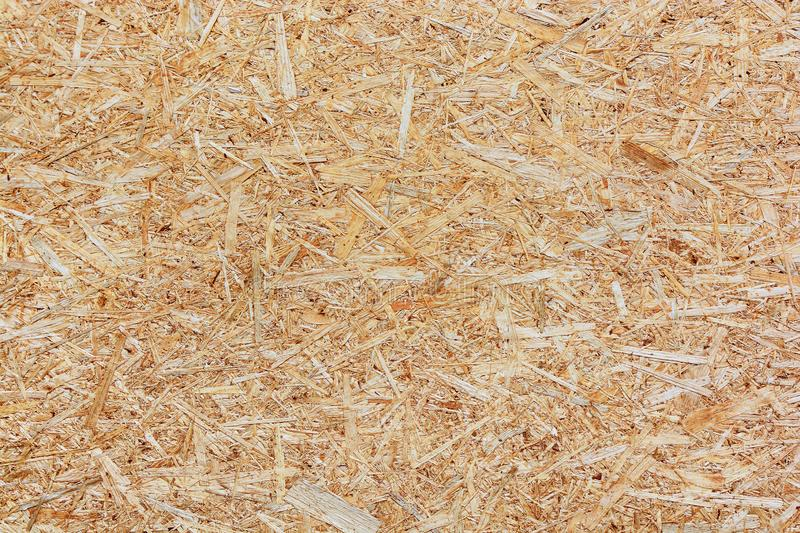 Background from wood fiber board, Wood chips. Background from wood fiber board. Pressed Wood  chips and sawdust royalty free stock photo