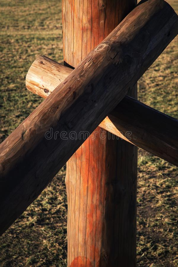 Wood round beams combined obliquely stock photography