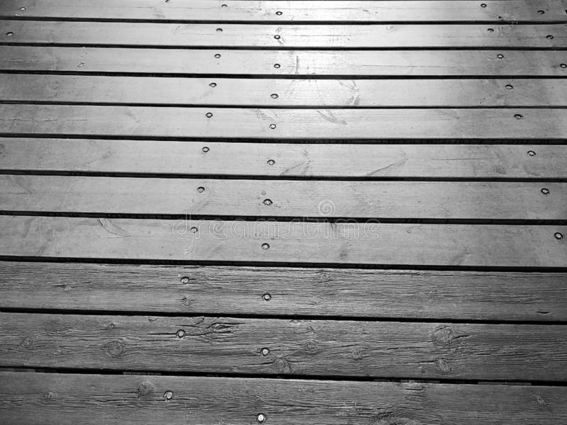 Background from a wooden board wooden boards with knots. in black and white royalty free stock images