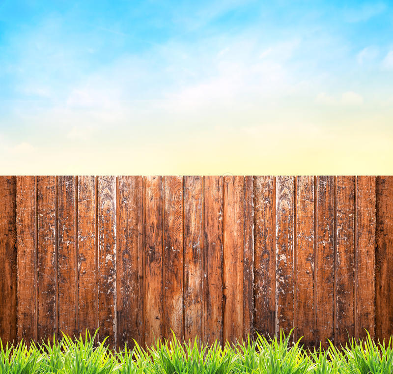 Background with wooden fence , grass and blue sky stock images