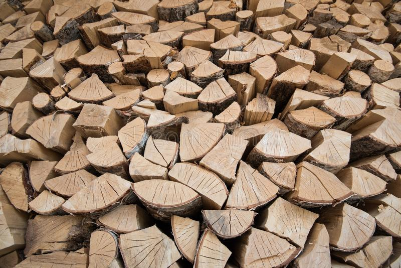 Background of wooden logs. Year rings. Pile wood. Deforestation theme. Wood industry. Chopped wood. Woodpile scene royalty free stock photo