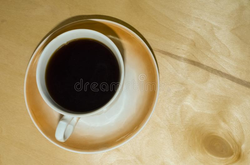 Checkered leaf, a Cup of black coffee. stock photography