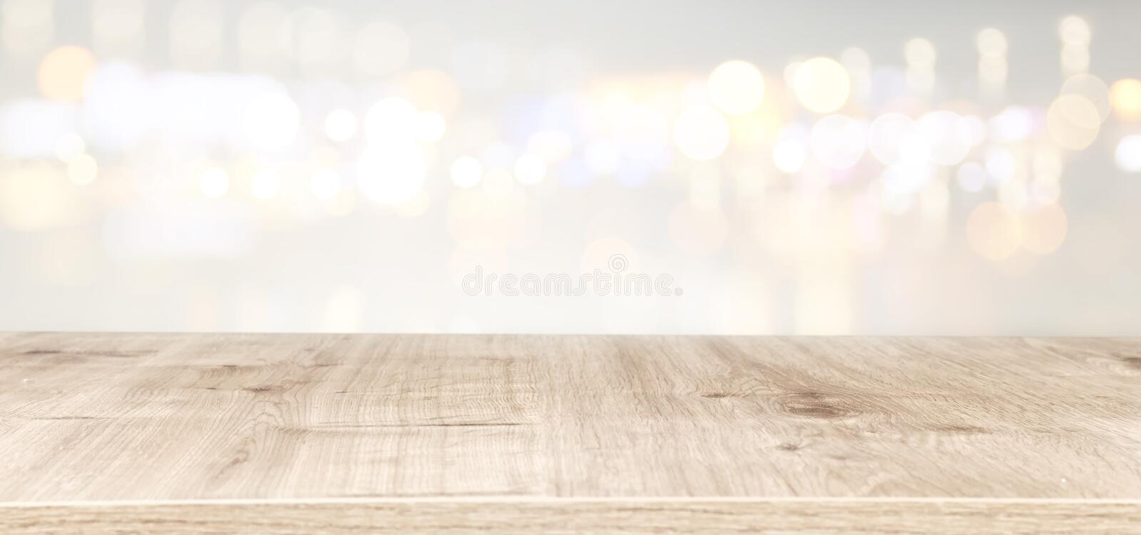 Background of wooden table in front of abstract blurred window light. banner.  stock photography