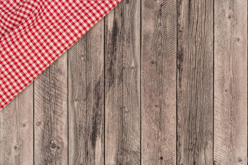 Background with wooden tabletop and checked tablecloth stock photography