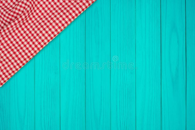 Background with wooden tabletop and checked tablecloth stock photos
