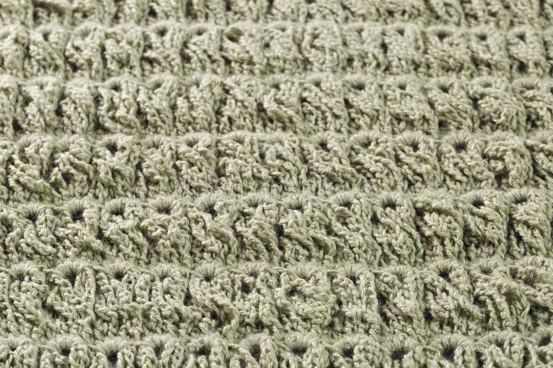 Background of woolen threads olive color. Background of woolen threads of olive color stock photos
