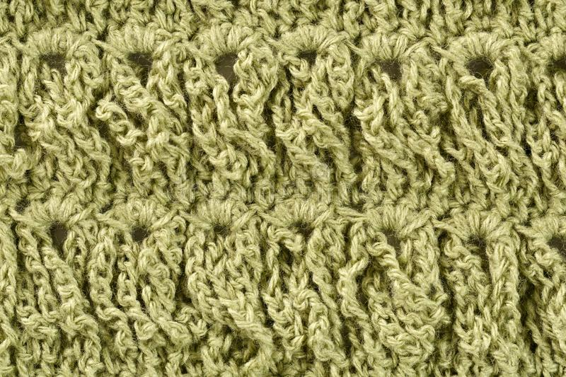 Background woolen threads of olive color. Background of woolen threads of olive color royalty free stock image