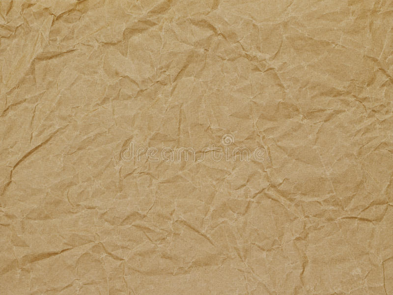 Background, wrapping paper, texture, brown, wrinkle. Kraft paper with larger wrinkles royalty free stock photo