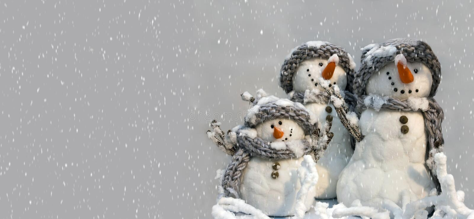 Background for xmas card of group of three snowmen royalty free stock photography