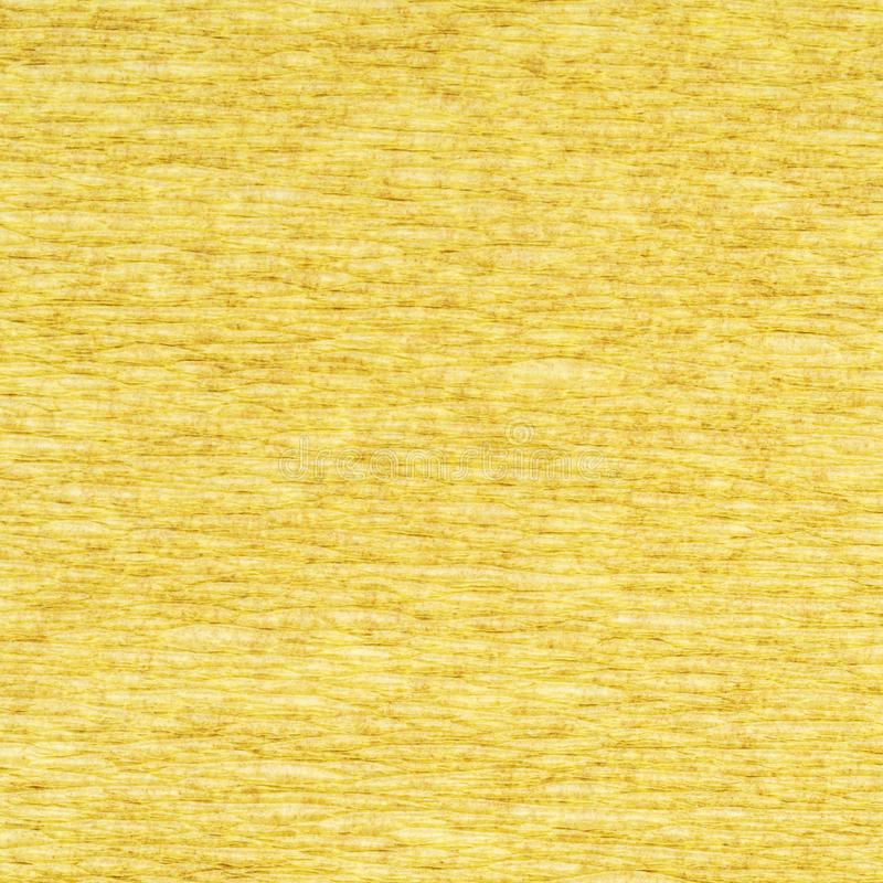 Background from yellow crepe paper. Background from yellow light goldenrod color crepe paper close up royalty free stock images