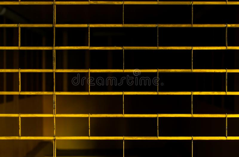 Background of yellow fence of garage stock photos