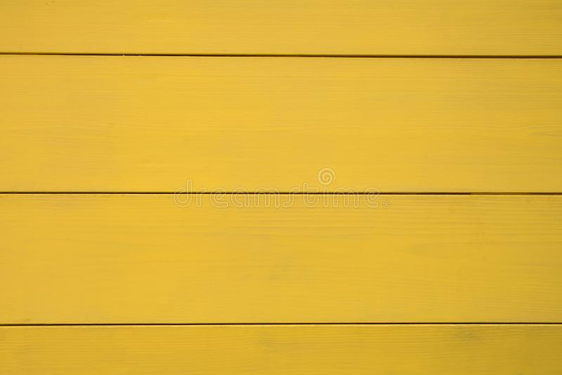 yellow wooden texture, fence of wooden boards, horizontal stripes stock images