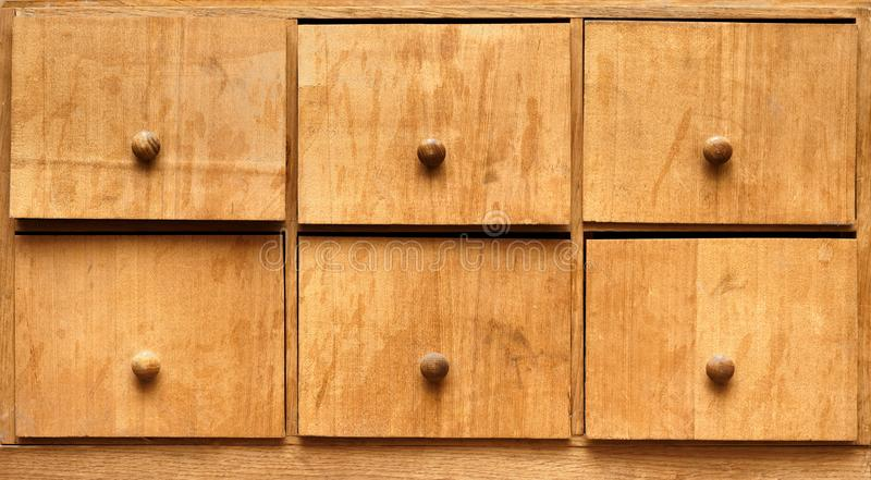 Old hand-made closet with pullout drawers royalty free stock photo