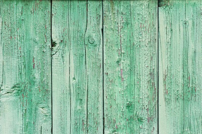 Backgrounds and texture concept - old wooden fence painted in blue background royalty free stock photo
